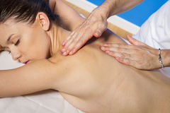Masseur doing massage on woman body in the spa salon. Beauty tre Royalty Free Stock Photography