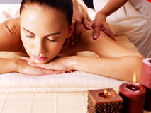 Masseur doing massage on woman body in spa salon Royalty Free Stock Photo