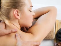 Woman having body massage in the spa salon stock photography