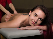 Masseur doing massage on woman body in the spa salon. woman relaxed. Beauty treatment concept.  Stock Photo