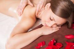 Masseur doing massage on woman body Royalty Free Stock Photo