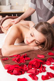 Masseur doing massage on woman body Royalty Free Stock Photography