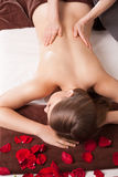 Masseur doing massage on woman body Stock Images