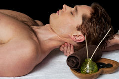 Masseur doing neck massage. Man relaxing getting neck back massage stock images