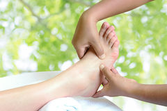 Masseur doing reflexology,Thai foot massage Stock Image