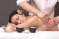 Masseur gettins massage beautiful young woman Stock Photos