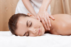 Masseur gives neck and shoulder massage Stock Photography