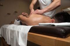 Masseur Giving Back Massage To A Man Royalty Free Stock Photography
