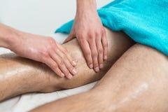 Masseur Giving Legs Massage To A Man Stock Photo