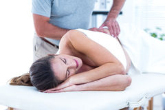 Masseur giving massage to woman Royalty Free Stock Photography