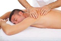 Masseur kneading man back at massage. Professional masseur kneading man back skin at massage in a spa salon royalty free stock photography