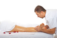 Masseur kneading woman leg Royalty Free Stock Photo