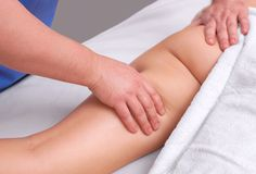The masseur makes Anti-cellulite massage on the buttock and thighs of the patient. Treatment of excess weight royalty free stock image