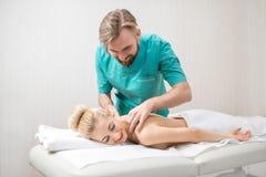 Masseur making a woman massage Stock Photography