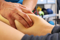 Masseur massaged his calf. Stock Images