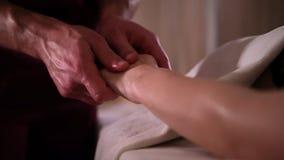 The masseur massages the girls hands brush under romantic light