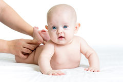 Masseur massaging baby Royalty Free Stock Photography