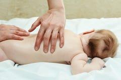 Masseur massaging a child Stock Images