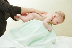 Masseur massaging a child. Masseur making a massage to child body royalty free stock photos
