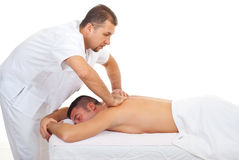 Masseur massaging man back at spa Stock Photo