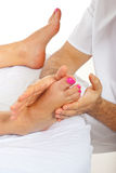Masseur massaging woman feet Stock Photography
