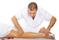 Masseur massaging woman's leg royalty free stock photos