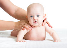 Masseur or mom massaging baby Royalty Free Stock Photos