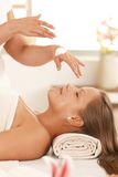 Masseur preparing cream. Masseur applying cream for facial massage stock images