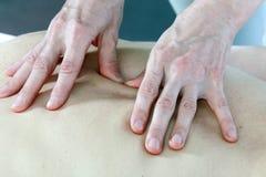 Masseur's hands Stock Image