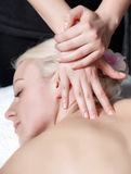 Masseur's hands doing deep tissue massage Stock Photography