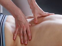 Masseur's hands Stock Photos