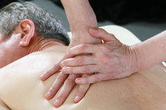 Masseur's hands Royalty Free Stock Photo