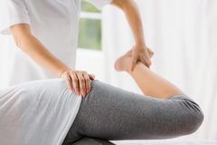 Masseur stretching woman Royalty Free Stock Image