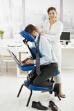 Masseur working in office stock photography