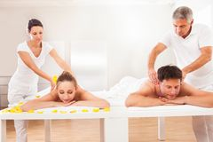 Masseurs giving back massages Royalty Free Stock Photos