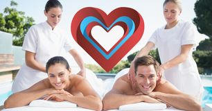Masseurs giving massage to happy couple Stock Photography