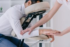 masseuse doing arm massage for businessman