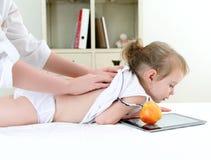 Masseuse doing massage Royalty Free Stock Photos