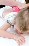 Masseuse doing massage Stock Image