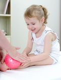 Masseuse doing massage to little girl Stock Photo
