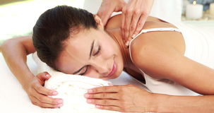 Masseuse giving massage to relax woman stock footage