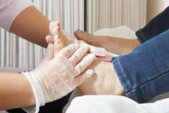 Feet massage. Masseuse makes feet massage. Horizontal closeup shot Stock Photography