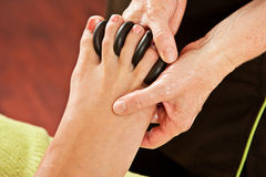 Hot rocks massage, feet Stock Image