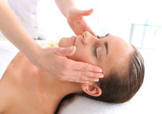 Masseuse - woman at face massage royalty free stock photo
