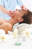 Masseuse - woman at face massage Stock Photography