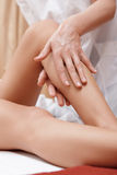 Masseuse works with feet and legs Royalty Free Stock Images