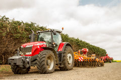 Massey Ferguson 8690 parked up with seed drill Royalty Free Stock Photos