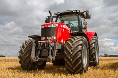 Massey Ferguson 7726 parked up on stubble in crop field Royalty Free Stock Photo