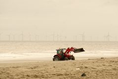 Massey Ferguson tractor on the beach. Royalty Free Stock Photography