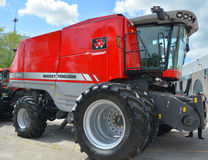 Massey Ferguson 9540 Trident. SAINT HYACINTHE QC CANADA JULY 25 2015: The Massey Ferguson 9540 Trident combine harvester is built in Hesston, Kansas, USA by Stock Images